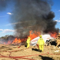 ACT Fire & Rescue firefighters working to extinguish the fire at Pialligo.